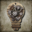 Bulb lamp with cogs and gears. Idea concept.
