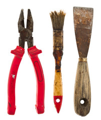 Old isolated tools:putty knife, pliers, brush