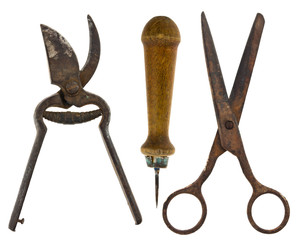 Old isolated tools:scissors, scissors for metal, awl