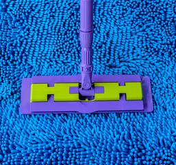 Vacuum cleaner on blue carpet