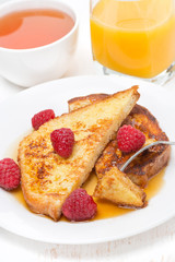 French toast with fresh raspberries and maple syrup