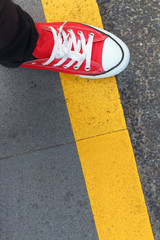 Shoes red on a black ground.
