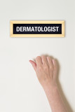Female hand is knocking on Dermatologist door poster