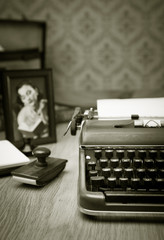 Writing a letter on vintage typewriter