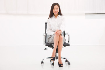 Smiling young businesswoman sitting chair