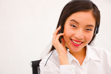 Close-up of a young smiling female customer service executive