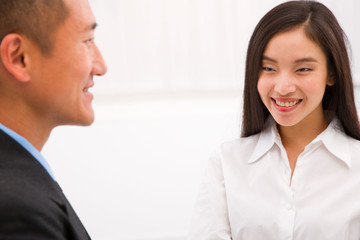 Close-up of happy businessman and businesswoman