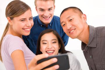 Group of multiethnic friends taking self portrait