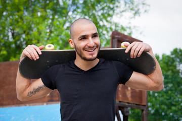 Man portrait with skateboard.