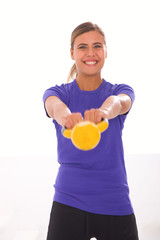 Happy fitness woman exercising with kettlebell