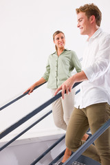 Happy young couple standing staircase