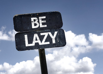 Be Lazy sign with clouds and sky background