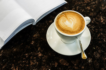 coffee on the table and reading book