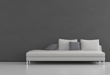 Weißes Sofa vor grauer Wand