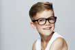 Portrait of young boy wearing glasses, studio. - 69048298