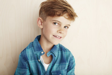 Portrait of young boy in checked shirt.