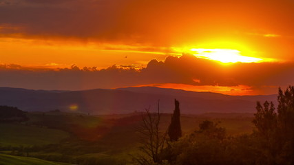 View of Val d'Orcia valley a sunset, timelapse . Tuscany, Italy