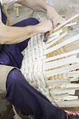 Craftsman making baskets