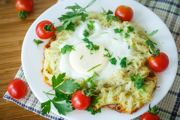 Egg baked in potatoes