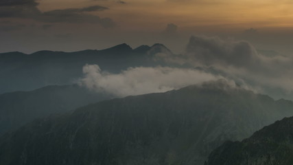 Fagaras Mountains Serbota clouds rolling over ridge  at sunset