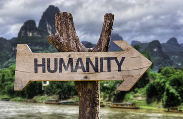 Humanity wooden sign with a forest background