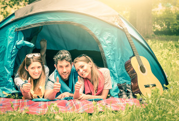 Group of best friends with thumbs up - Fun camping together