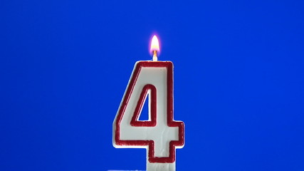 Number 4 - four birthday candle burning