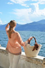 Girl with a basket bag at the Como lakem Italy