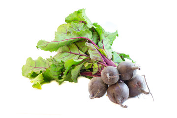 Bunch of beetroots with greens isolated