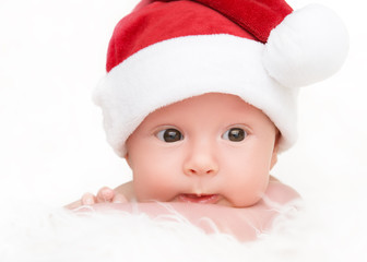 cute newborn baby in christmas hat