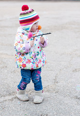 Toddler girl playing on a walk