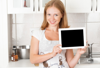 woman housewife in the kitchen with empty tablet computer