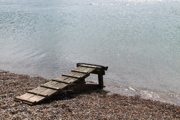 A Wooden Landing Stage from a Beach to a Boat.