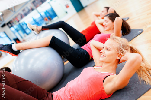 group of people working out in pilates class - 69054265