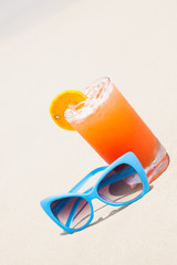 picture of fresh orange and grapefruit juice and sunglasses on