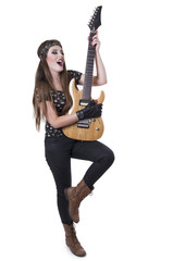 Young pretty blond rocker girl playing electric guitar