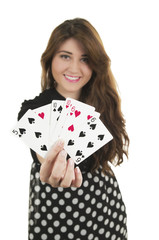 Beautiful young girl holding cards in her hand