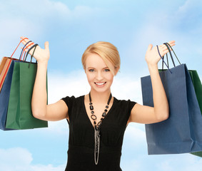 lovely woman with shopping bags