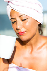 Woman is drinking Coffee on the balcony