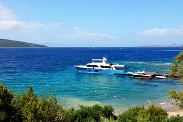 Recreation yacht at the pier on Turkish resort,  Bodrum, Turkey