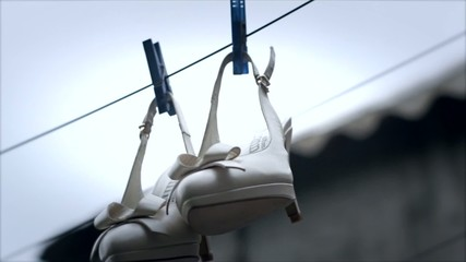 Women's shoes hanging on a clotheslin