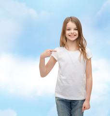 smiling little girl in blank white t-shirt