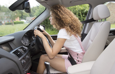 Bad posture and bad driving position. Female motorist