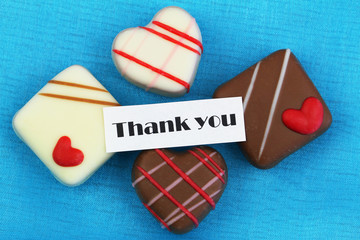 Thank you card with chocolates on blue background