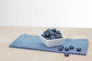 Fresh blueberries in square dish