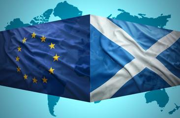 Waving Scottish and European Union flags