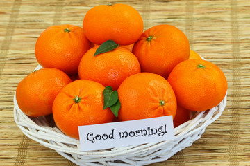Good morning card with wicker basket full of mandarines