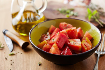 Bowl of raw tomato salad
