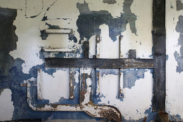 shabby old wall with rusty metal details