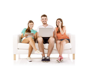 Young people on sofa with laptop